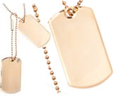 Set of 2 gold plated dog tags. Measures 1 1/8w x 1 15/16h x 2mm d